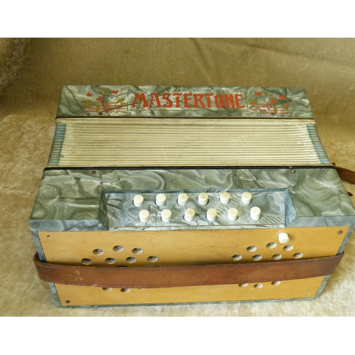 697 - A Mastertone Accordion (front panel missing) in fitted leather carrying case...