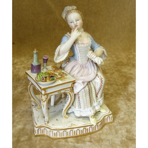 7 - A Meissen Figure of a Seated Lady eating from table, 13cm high...