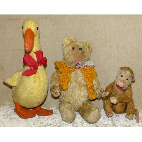 702 - A Child's Teddy Bear having jointed body, 36cm high, a child's monkey 18cm high, also a similar chil...