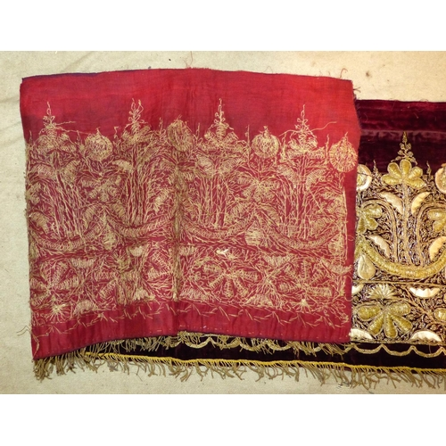 704 - A Gold Thread Long Panel on red velvet having floral, leaf and scroll decoration, 2m 61cm long x 33c...