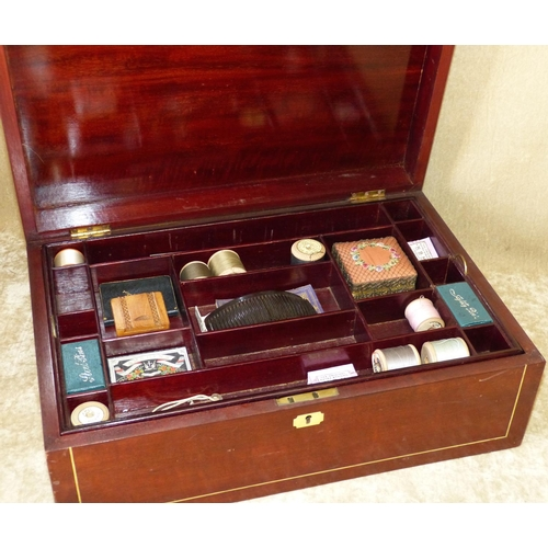 707 - A 19th Century Mahogany Rectangular Shape Sewing Box having inlaid stringing, hinged lid enclosing s...