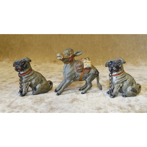 721 - A Pair of Painted Metal Figures of Seated Dogs, 4cm high also a similar painted metal figure of a do...