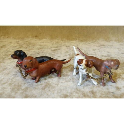 723 - A Group of 2 Cold Painted Metal Figures of Dachshunds also another cold painted group of 2 dogs (2)...