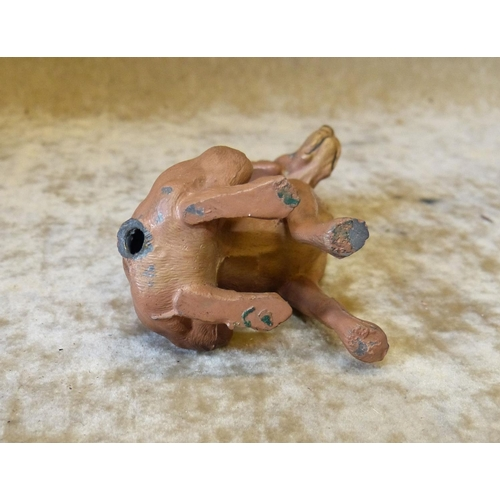 725 - A Cold Painted Metal Figure of a seated dog (tail missing) 9cm high...