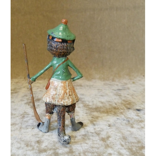 726 - A Cold Painted Metal Figure of a standing cat in Scottish outfit holding an oar, 11cm high...
