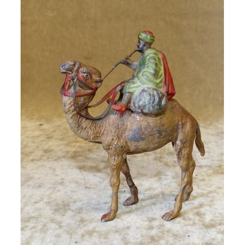 730 - A Cold Painted Metal Figure of an Egyptian Gentleman riding a camel, 11cm high...