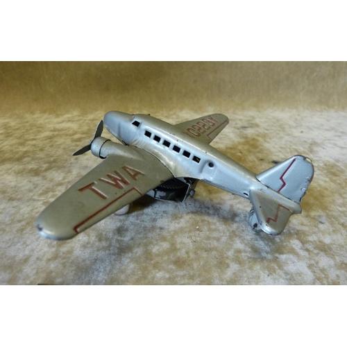 738 - A Clockwork TWA NC223Y Aeroplane 12cm long...