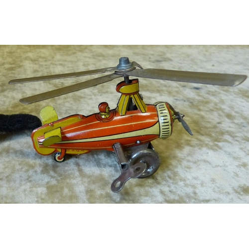 743 - DRGM German Tin Clockwork Helicopter, 9cm long...