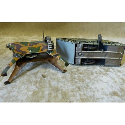 744 - A German Tin Clockwork WWI Tank, 13cm long also a clockwork key wind machine gun (2)...