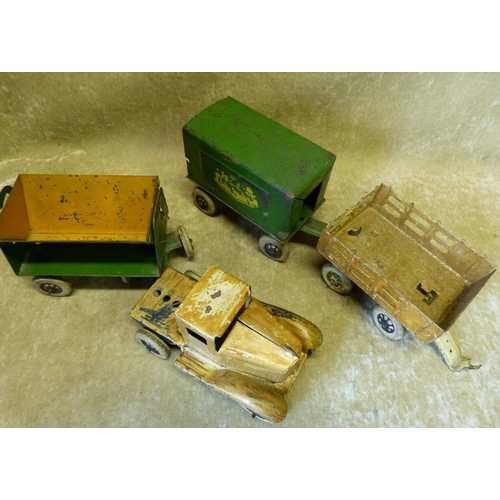 748 - A Child's Tin Model of a Truck with 4 carriages, 72cm long overall...