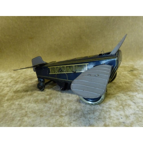 749 - SG German Tin Clockwork Aeroplane, 17cm long...