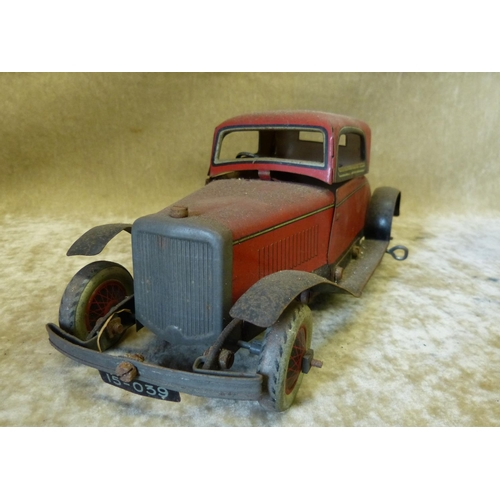 750 - A Burnette Ltd Tin Clockwork Red Car, 25cm long...