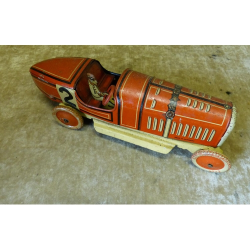 751 - A Child's Clockwork German Tin Red Racing Car, 26.5cm long...