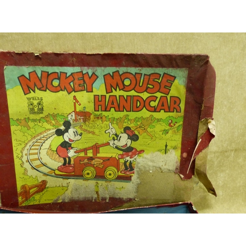 753 - A Wells, London O'Gauge Clockwork Tin Plate Mickey Mouse Handcar with celluloid figures, track, boxe...