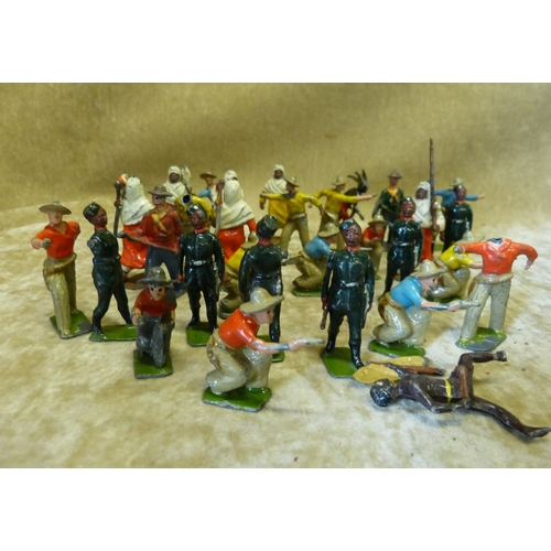 757 - A Quantity of Britians and other Lead Figures of American Cowboys, Eastern Military figures and a qu...