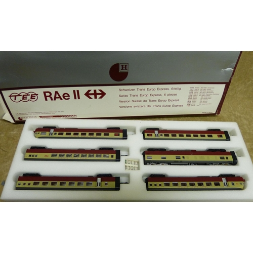772 - A Hobbytrain Tee Rae II Train Set, boxed and 4 similar loose carriages...