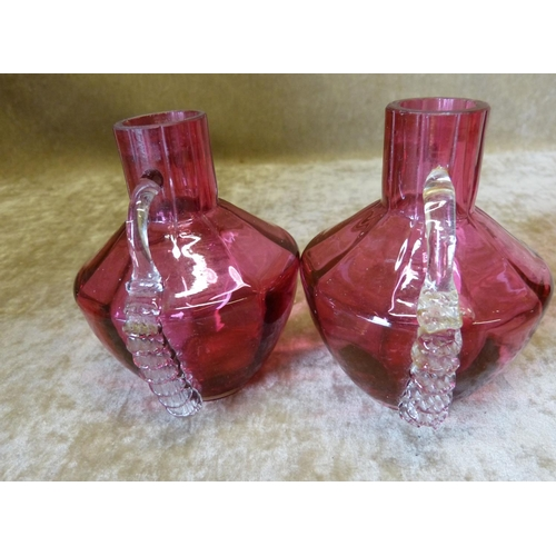79 - A Pair of Ruby Glass Bulbous Thin Neck 2-Handled Vases 10cm high...