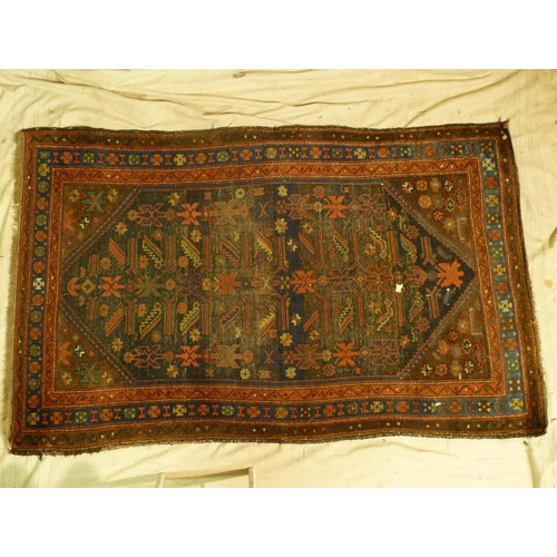797 - A Persian Rug on red, blue and brown ground, centre medallion with further smaller medallions, 1m 98...