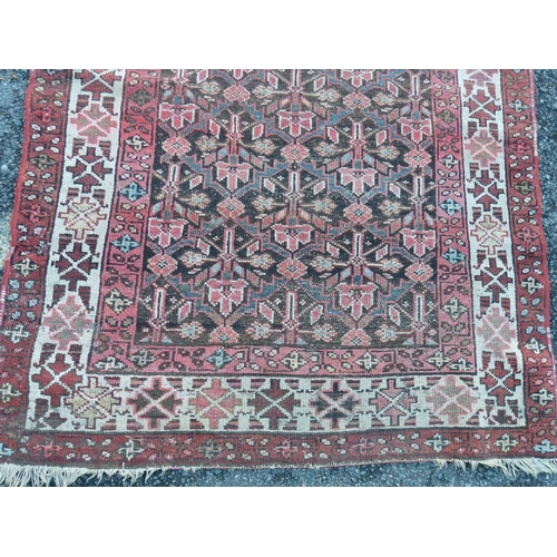 798 - A Persian Runner on red and white ground having all over medallions, 2m 78cm, 1m 13cm...