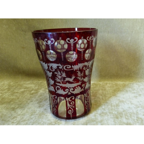 80 - A Ruby and Clear Glass Bohemian Style Round Trumpet Shape Vase having animal floral, leaf and scroll...
