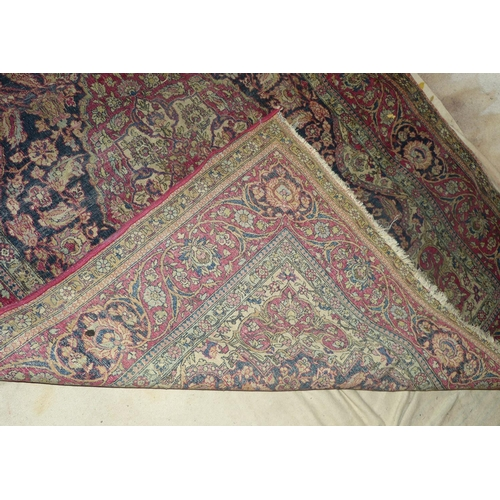 800 - A Persian Rug on red and blue ground having centre medallion (worn and cut to side) 2m, 1m 42cm...
