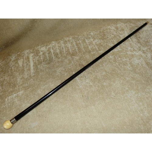 809 - A Royal Navel Air Force Ebonised Walking Cane having Ivory knob handle with silver neck inscribed T....