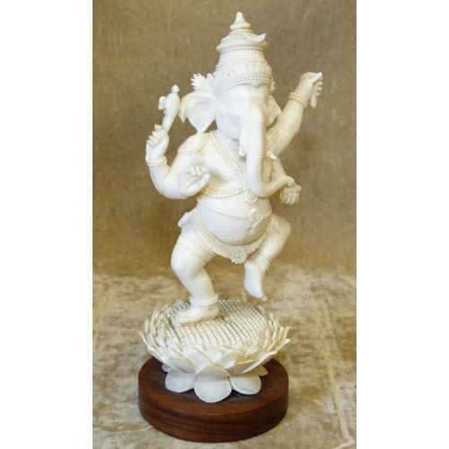 810 - An Early 20th Century Ivory Figure of a Dancing Elephant God on hardwood stand, 14cm high...