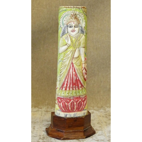 812 - A 19th/20th Century Indian Painted Ivory Figure of a Lady on hardwood stand, 19cm high...