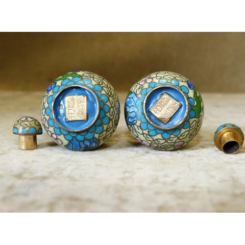 825 - A Pair of Signed Cloisonné Miniature Gourd Snuff Bottles with covers on cream ground with multicolou...