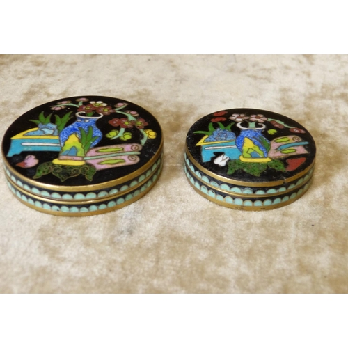 826 - 2 Graduated Signed Oriental Cloisonné Round Lidded Pots on black ground with multicoloured vase, flo...