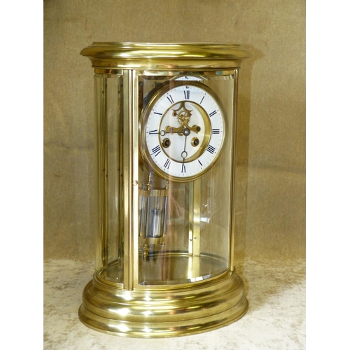 843 - A Large Oval Brass 8 Day Striking Visible Movement Mantle Clock having white enamel dial with Roman ...