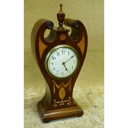 845 - An Edwardian Mahogany Timepiece having swan neck top with turned finial, marquetry inlaid swag, shel...