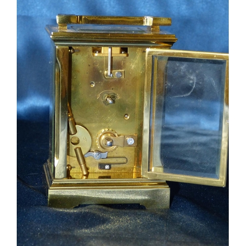 848 - A Similar Brass Carriage Clock having chamfer corners, white enamel dial with Roman numerals, swing ...