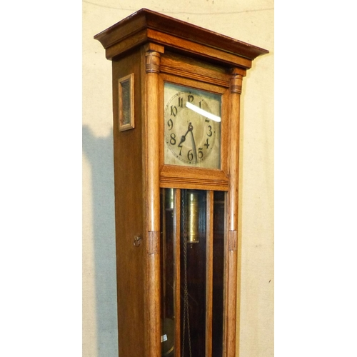 849 - A Light Oak Arts and Crafts Style Longcase Clock having silvered dial with Arabic numerals, panelled...