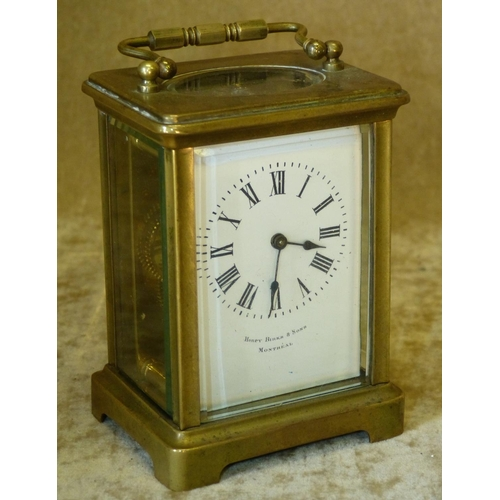 854 - Henry Birks & Sons, Montreal Brass Carriage Clock having swing overhead handle, 12cm high...