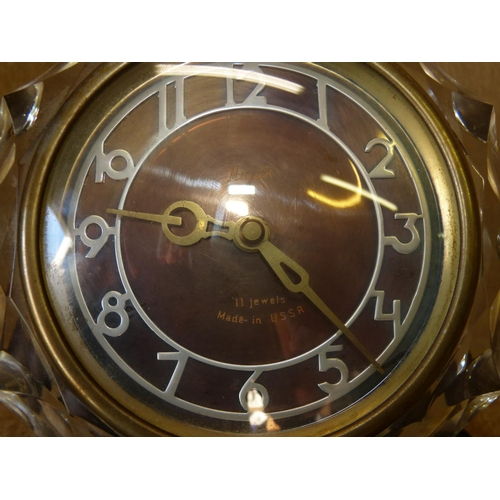 855 - A Russian Glass Metal Timepiece having Arabic numerals on black plastic base, 17cm high...
