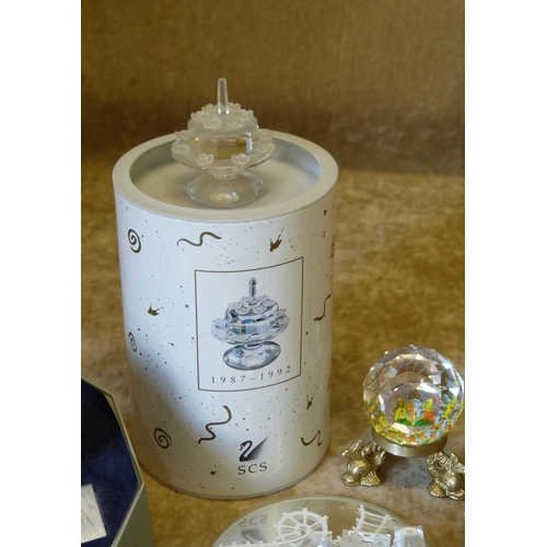 86 - A Quantity of Various Swarovski Crystal Flowers, Paperweight, Train Set, Hearts etc....