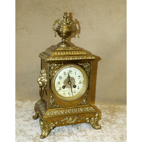 860 - Japy Freres Gilt Metal 8 Day Striking Mantle Clock having urn motif, with all over raised floral and...