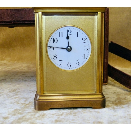 861 - A Brass Repeat Half Striking Carriage Clock with round white enamel dial having Arabic numerals, swi...
