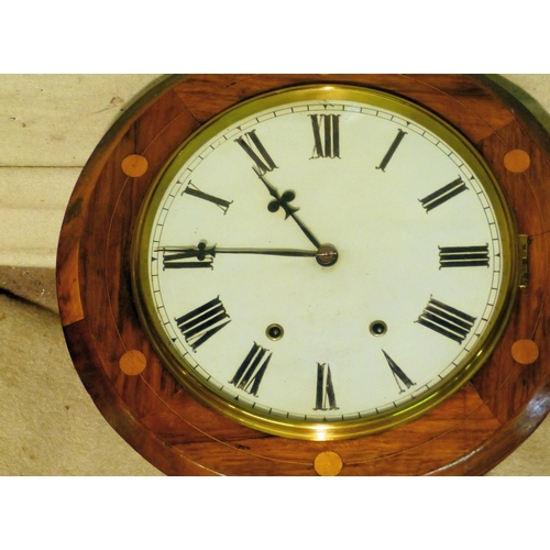 866 - A Mahogany 8-Day Striking Hanging Wall Clock having round silvered dial with Arabic numerals, oval b...