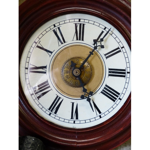 869 - A Mahogany Hanging Alarm Wall Clock with cream dial and Roman numerals, 28cm diameter...