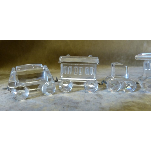 87 - A Swarovski Crystal 2-Section Train (boxed) and 2 x Swarovski crystal carriages (boxed)...