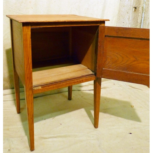 875 - An Oak Bedside Cupboard having single panelled door, on square tapering legs, 50cm wide...