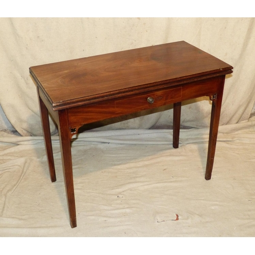 876 - A 19th Century Mahogany Tea Table having hinged top, dummy drawer to front with brass knob handles o...