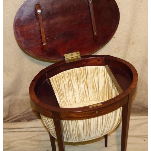 877 - A 19th Century Mahogany Oval Worktable having banded and inlaid boxing decoration, hinged lid enclos...