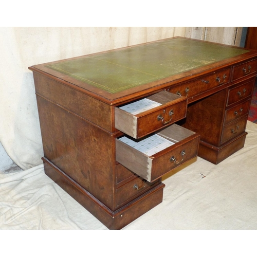 878 - A Good Quality Reproduction Walnut Mahogany Kneehole Double Pedestal Desk having green leather inset...