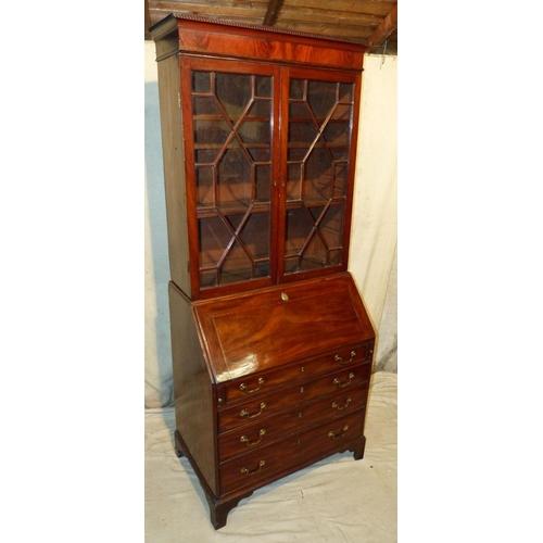 879 - A George III Mahogany Bureau Bookcase having 2 astragal glazed doors enclosing adjustable shelves, f...