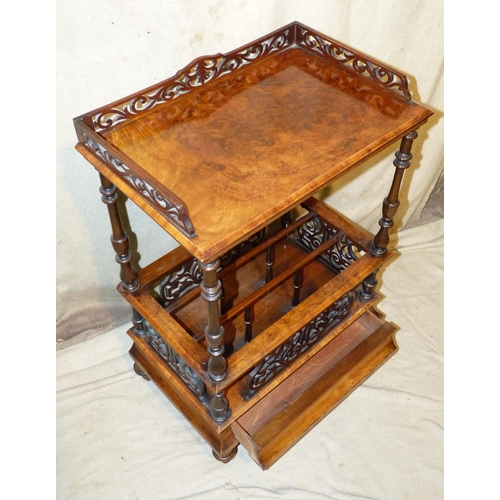 884 - A Victorian Burr Walnut Canterbury Whatnot having pierced frieze, turned supports having further car...
