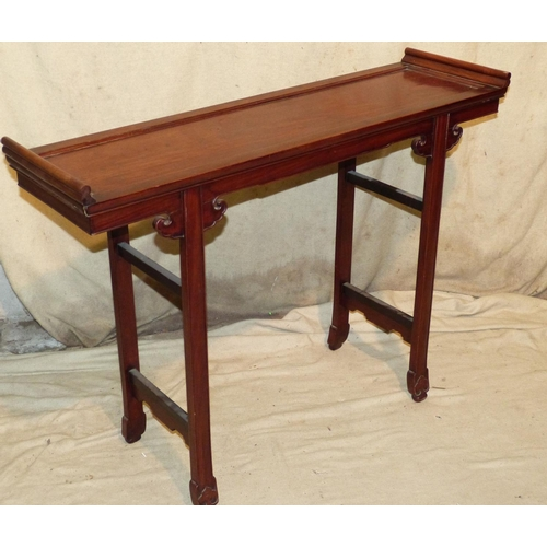 887 - A 20th Century Oriental Alter Table having scroll ends on splayed legs, 1m 11cm wide, 82cm high...