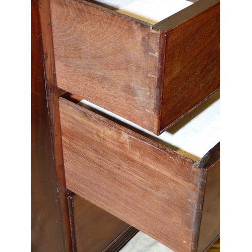 893 - A 19th Century Mahogany Small Straight Front Chest of Drawers having 2 short, 2 long drawers with dr...